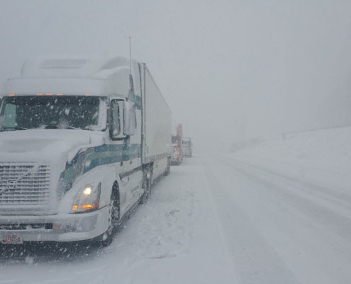 Hayes Transport truck driving in the snow